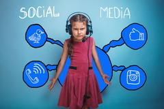 Adolescence girl with headphones spreading her arms to the side Stock Photos
