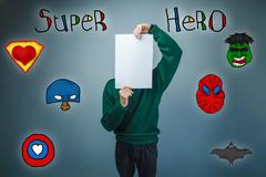 Boy in green sweater holding a face sheet of clean paper superhe Stock Photos