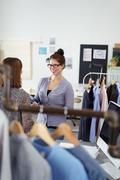 Stock Photo of two women talking in a fashion design studio