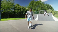 4K Talented young soccer players at skate park showing off ball skills - stock footage