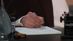 Vintage hand-writing on desk (1910s-1950s) Stock Footage