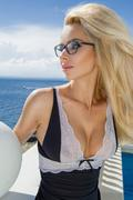 Beautiful blond hair sexy woman young girl model in sunglasses and elegant wh - stock photo