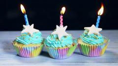 Christmas cupcakes and candles Stock Footage