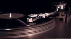 Vinyl record playing in turntable Stock Footage