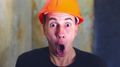 Man helmet construction worker in a hard hat architect surprised emotions Stock Footage