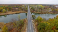 Aerial: flight over road in the forest. - stock footage