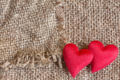 Decorative hearts on canvas background Stock Photos