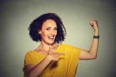 Healthy model woman flexing muscles confident showing her strength Stock Photos