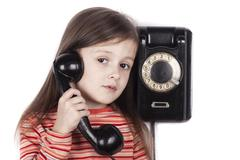 Serious sad child talking on phone isolated, white background - stock photo