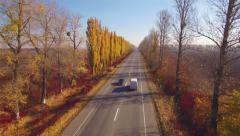 Aero Flight over the road between fields. Autumn colors. - stock footage