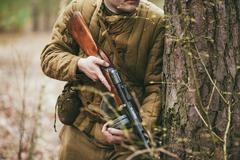 Unidentified re-enactor dressed as Soviet soldier in camouflage - stock photo