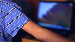 Teenage boy playing close-up computer game video sitting back room evening Stock Footage