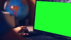Green key teenage boy playing computer close-up hands game video sitting back Stock Footage
