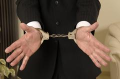 arrest, police male hands in handcuffs - stock photo