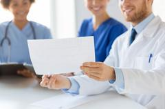 Stock Photo of close up of doctors with cardiogram at hospital