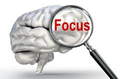 Stock Illustration of focus word on magnifying glass and human brain