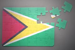 puzzle with the national flag of guyana - stock photo
