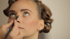 Make-up artist making eye liner to model fashion show - stock footage
