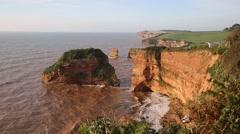 Sandstone rock stacks Ladram Bay Devon England UK Jurassic Coast - stock footage