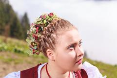 Portrait of a young girl in traditional costume with headdress Stock Photos