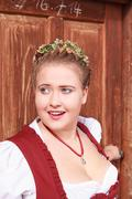 Face portrait of a young woman in dirndl with  elaborate hairstyle Stock Photos
