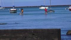 Hawaiian women on paddle board, ethnic islanders Stock Footage