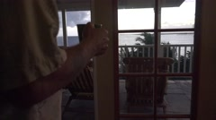 Coffee morning and French doors to lanai   ,Hawaii  Stock Footage