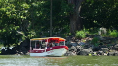 Boat with tourists at monkey island Stock Footage