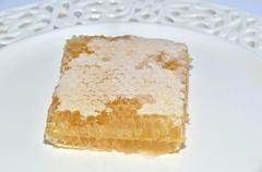 Waxy structure of honeycomb - stock photo