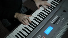 A man playing the piano musician keyboardist in a band in a dark room in the stu Stock Footage