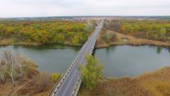 Stock Video Footage of Aerial: flight over road in the forest.