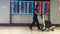 passangers in Suvarnabumi international airport in Bangkok city - stock footage