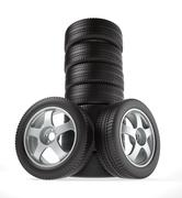 New car wheel stacked up and isolated on white background - stock illustration