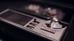 Turning on a vintage tape recorder Stock Footage