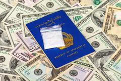 Package with drug over the Afghanistan passport and U.S. dollars Kuvituskuvat