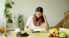 Woman finish reading book and feel dissatisfied about ending - stock footage