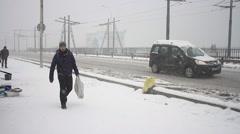 Car traffic on the snow covered Galata Bridge - stock footage