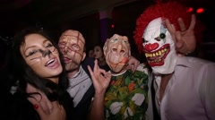 Celebrating Halloween in nightclub in costume party. Slow motion - stock footage