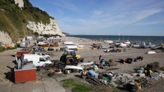 Beer beach Devon England UK with boats and fishing equipment Stock Footage
