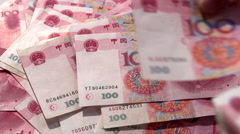 Chinese banknotes. Man recalculates banknotes Stock Footage
