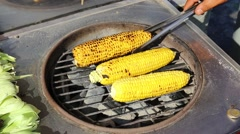 cooking corn cobs on the grill on the market in Istanbul - stock footage