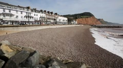 Sidmouth beach Devon England UK with pebbles and waves Stock Footage