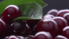 Ripe cherries on a black background. Rotation 360. Stock Footage
