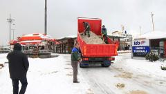 Salt truck spreads salt at pier Stock Footage