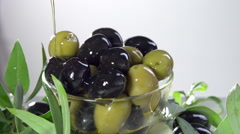 Olives. Green and black olives poured with olive oil. Slow motion 240 fps. Stock Footage