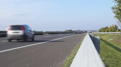 Freeway traffic view from guard rail Stock Footage