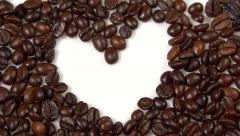 Coffee background. coffee beans fall. heart of the coffee beans Stock Footage