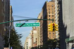 street sign suspended above Central Park West in New York City - stock photo