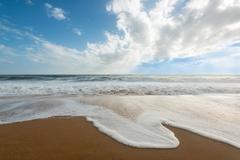 Waves on the beach Stock Photos