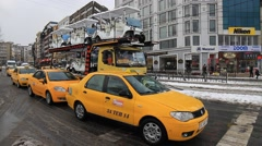 Cabs and tram passing on snow covered street at Sirkeci in Istanbul, Turkey Stock Footage